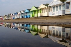Beach Huts reflected by St John Burkett